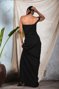 Black draped one shoulder gown with corset embellishment on other side and side slit
