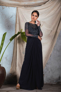 Black jersey draped gown with full sleeves and embellishment on the top and sheer embellished back