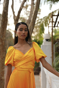 Yellow tie up dress with asymmetric heat pleated flare