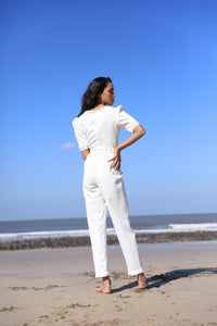 White jumpsuit with rivet detailing