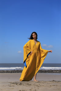 Yellow Kaftan dress with blue hem detailing along the sleeves