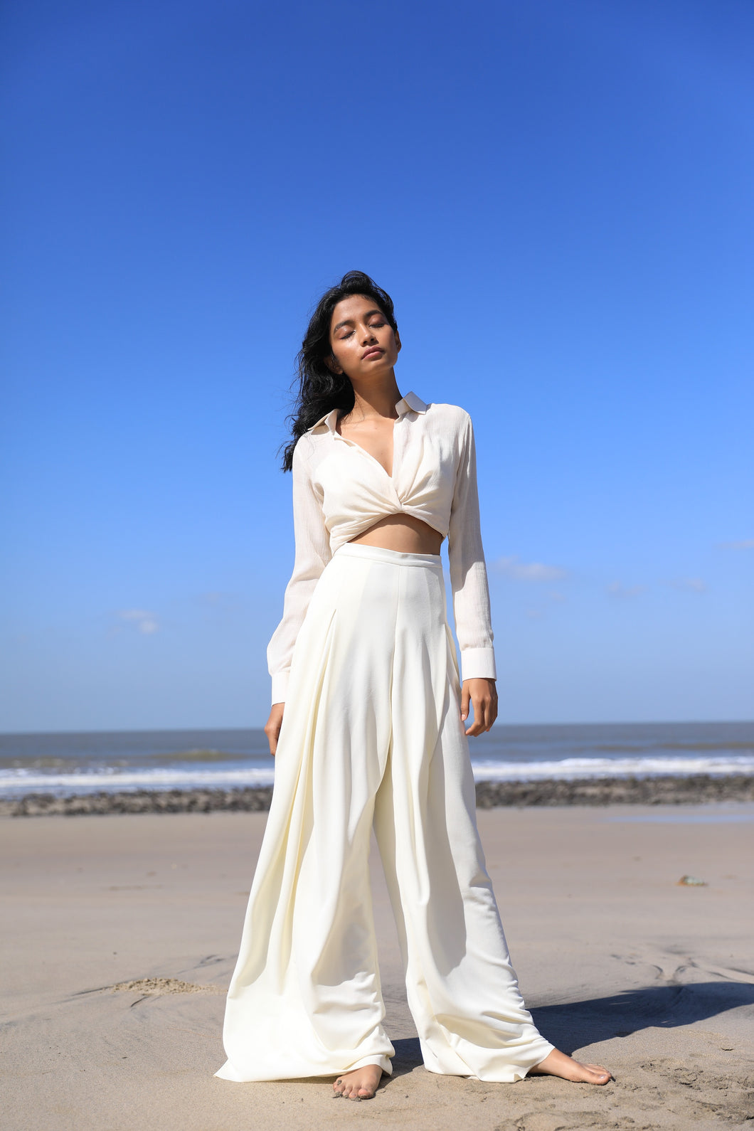Ivory draped shirt with wide pleated pants