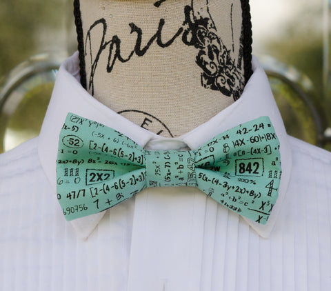 Turquoise Math Equations Bow Tie. Mens Bow Ties for weddings, prom, graduation, parties and formal events. Bow Ties are handmade, pretied and made in Canada. Made by Mr. Bow Tie.