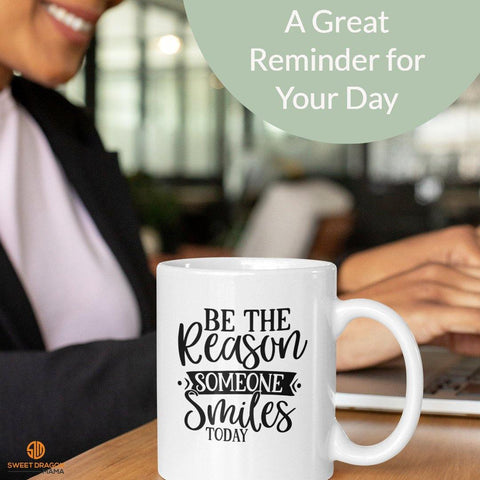 """Be the Reason Someone Smiles Today"" 11 oz High-quality white ceramic mug Microwave and dishwasher safe Measures 3.75"" tall kindness compassion gratitude"