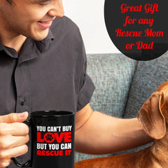 """You Can't Buy Love But You Can Rescue It"" 15 oz. Black Mug Great gift idea for any rescue Mom or Dad.  High quality ceramic mug Dishwasher safe Microwave safe"