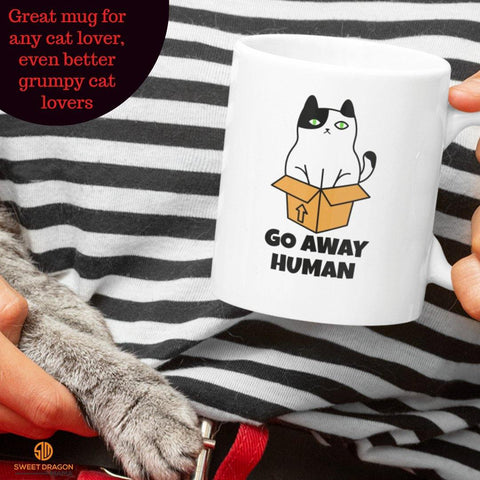 "Cat Box Go Away Human,white coffee mug, great gift for any cat lover or treat yourself! Even better for grumpy cat lovers! 11 oz volume capacity High-quality white ceramic mug Microwave and dishwasher safe Measures 3.75"" tall"