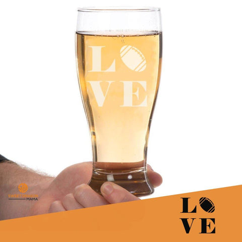 """Love Football"" Pilsner Glass Heavy-weight glass pilsner is strong and sturdy and will stand up to use indoors and outdoors. We also love them for smoothies!"