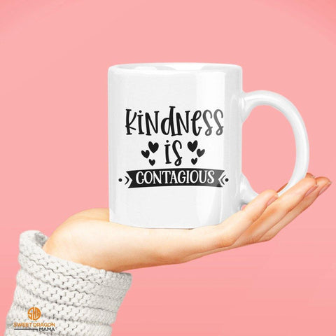 Kindness is Contagious White Coffee Mug Keep spreading it. 11 oz volume capacity High-quality white ceramic mug Microwave and dishwasher safe