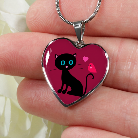surgical stainless steel necklace with heart pendant with patent pending poured glass dome, black cat with orange bird and pink heart, maroon background, made and shipped from USA personalized engraving on back