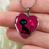 Image of surgical stainless steel necklace with heart pendant with patent pending poured glass dome, black cat with orange bird and pink heart, maroon background, made and shipped from USA personalized engraving on back