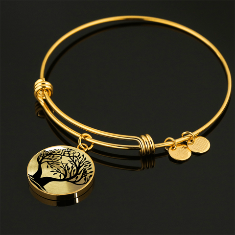 This classic Tree of Life design is available in silver ( surgical stainless steel) or with 18k gold plating. Both the bangle bracelet or the necklace can be engraved on the back.