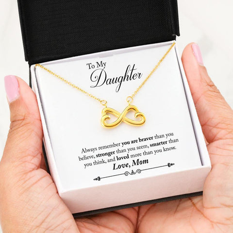 """To My Daughter: Always remember that you are braver than you believe, stronger than you seem, smarter than you think, and loved more than you know"" Love, Mom  Celebrate your everlasting love and express your affection with a look that says ""I'll love you til the end of time."" Artisan crafted in 14k White Gold finish or 18k Yellow Gold finish, this heart-shaped infinity symbol"
