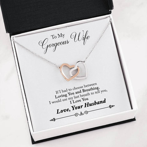 """To My Gorgeous Wife; if I had to choose between Loving You and Breathing, I would use my last breath to tell you , I Love You""""  Two hearts embellished with Cubic Zirconia stones, interlocked together as a symbol of never-ending love. Made with high quality polished surgical steel."