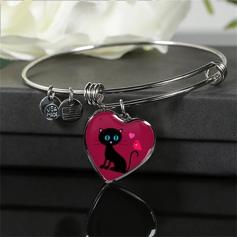 surgical stainless steel bangle bracelet with heart shaped charm with patent pending poured glass dome, black cat with orange bird and pink heart, maroon background, made and shipped from USA personalized engraving on back ,  gift box comes free with product, free engraving, shown on black giftbox