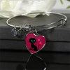 Image of surgical stainless steel bangle bracelet with heart shaped charm with patent pending poured glass dome, black cat with orange bird and pink heart, maroon background, made and shipped from USA personalized engraving on back ,  gift box comes free with product, free engraving, shown on black giftbox