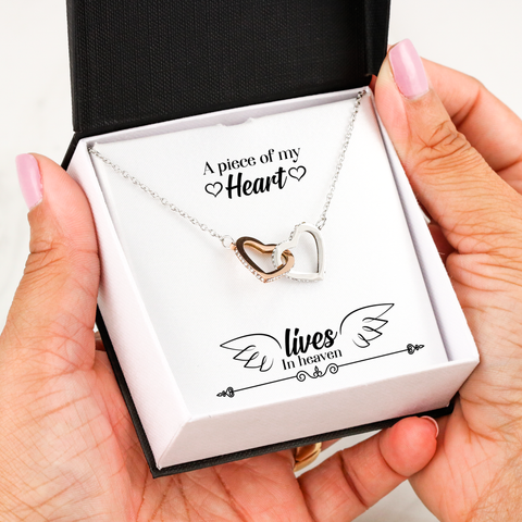 "Remembrance ""A piece of my heart lives in heaven""  Interlocking Heart necklace  Two hearts embellished with Cubic Zirconia stones, interlocked together as a symbol of never-ending love. Made with high quality 18k Rose Gold and polished surgical steel."