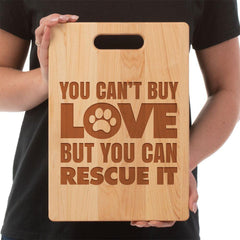 """You Can't Buy Love But You Can Rescue It"" handmade maple Cutting Board Hand made and laser engraved in the United States Use the laser engraved side for display on a counter or as wall decor, serving platter for cheeses, sandwiches, appetizers,or a charcuterie platter.  Made of Maple, the other side is a sturdy and long lasting cutting board that doesn't stain or retain odors. Medium- 8 3/4""X11 1/2"" Large- 9 3/4""X 13 1/2"""