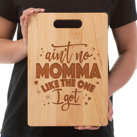 """Ain't No Momma Like the One I Got"" handmade maple Cutting Board Hand made and laser engraved in the United States Use the laser engraved side for display on a counter or as wall decor, serving platter for cheeses, sandwiches, appetizers,or a charcuterie platter.  Made of Maple, the other side is a sturdy and long lasting cutting board that doesn't stain or retain odors.Medium- 8 3/4""X11 1/2"" Large- 9 3/4""X 13 1/2"""