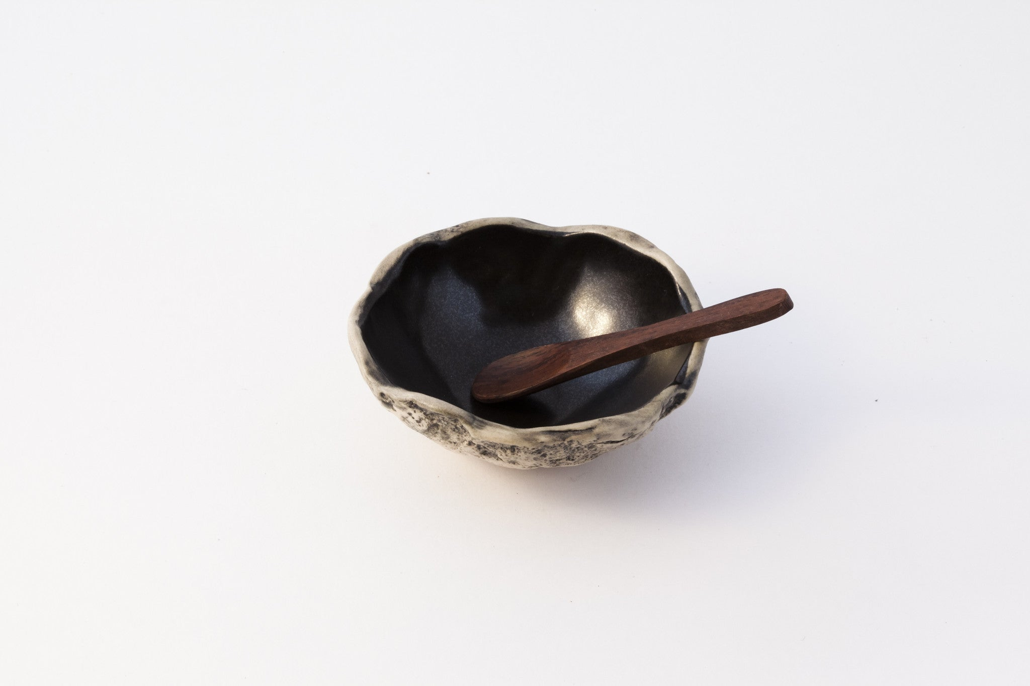 Spice bowl with spoon