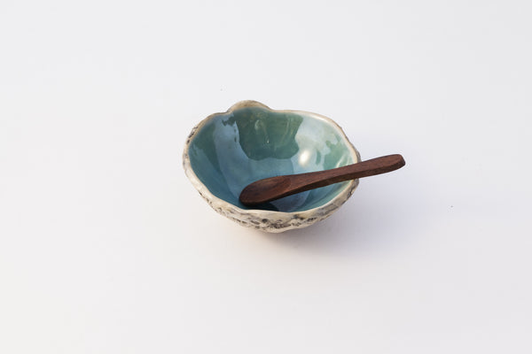 Spice-bowl with wooden spoon