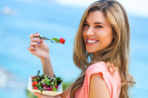 Healthy lifestyle woman eating salad