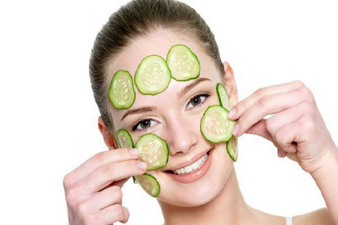 woman with cucumbers on face