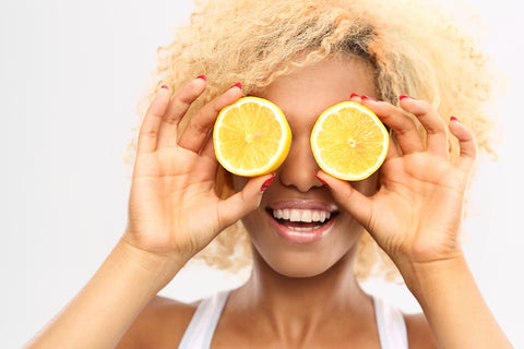 girl with lemons over eyes