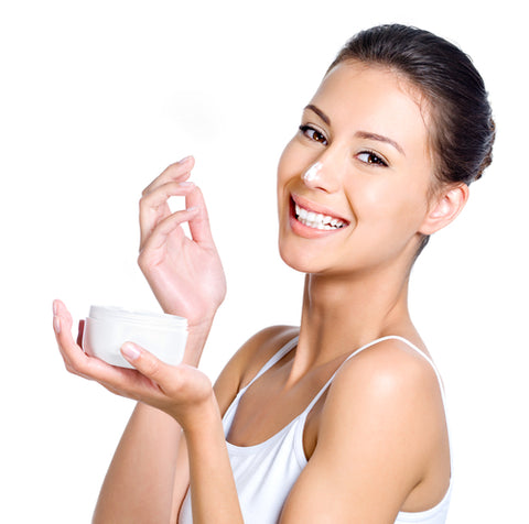 Woman applying skin cream