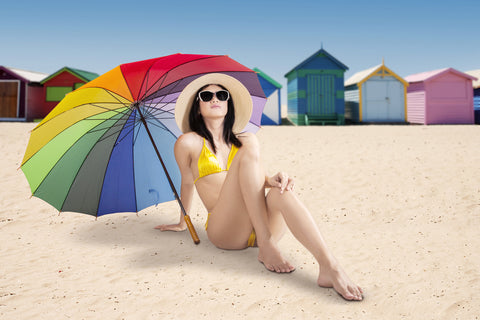 woman at beach under umbrella