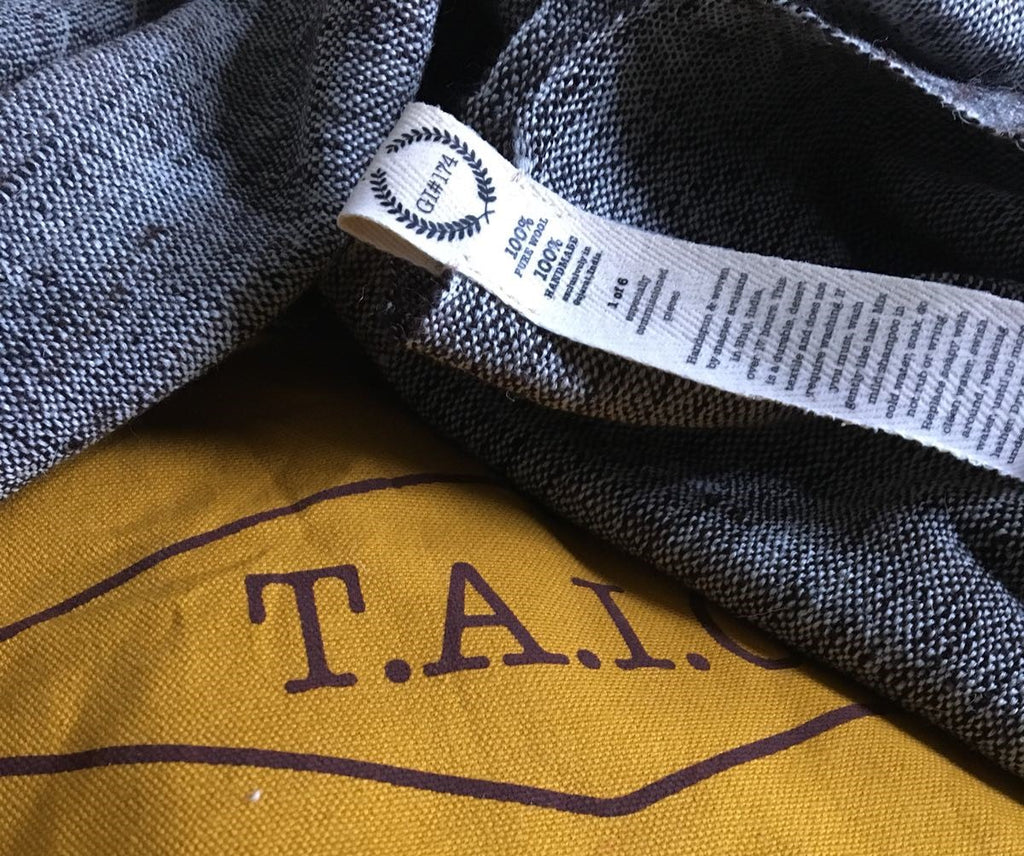 Image of GI174 tag attached to a TAIC Kachchh Shawl throw
