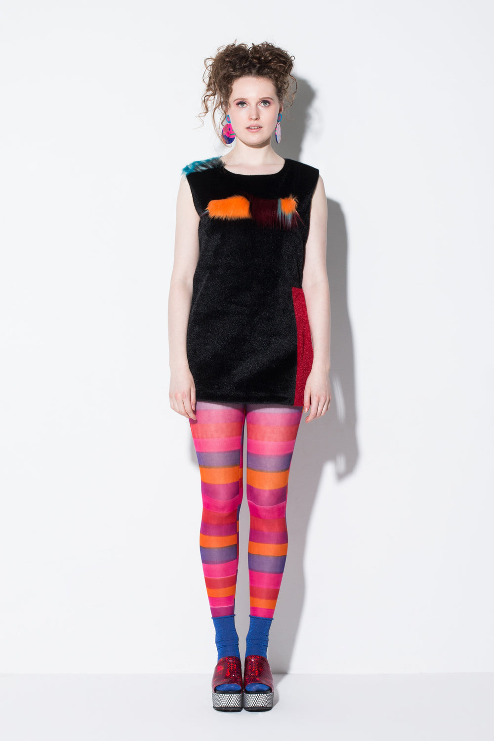 day meets night|a key piece faux fur mid-length vest in black orange and blue colour-way from jin & yin front view