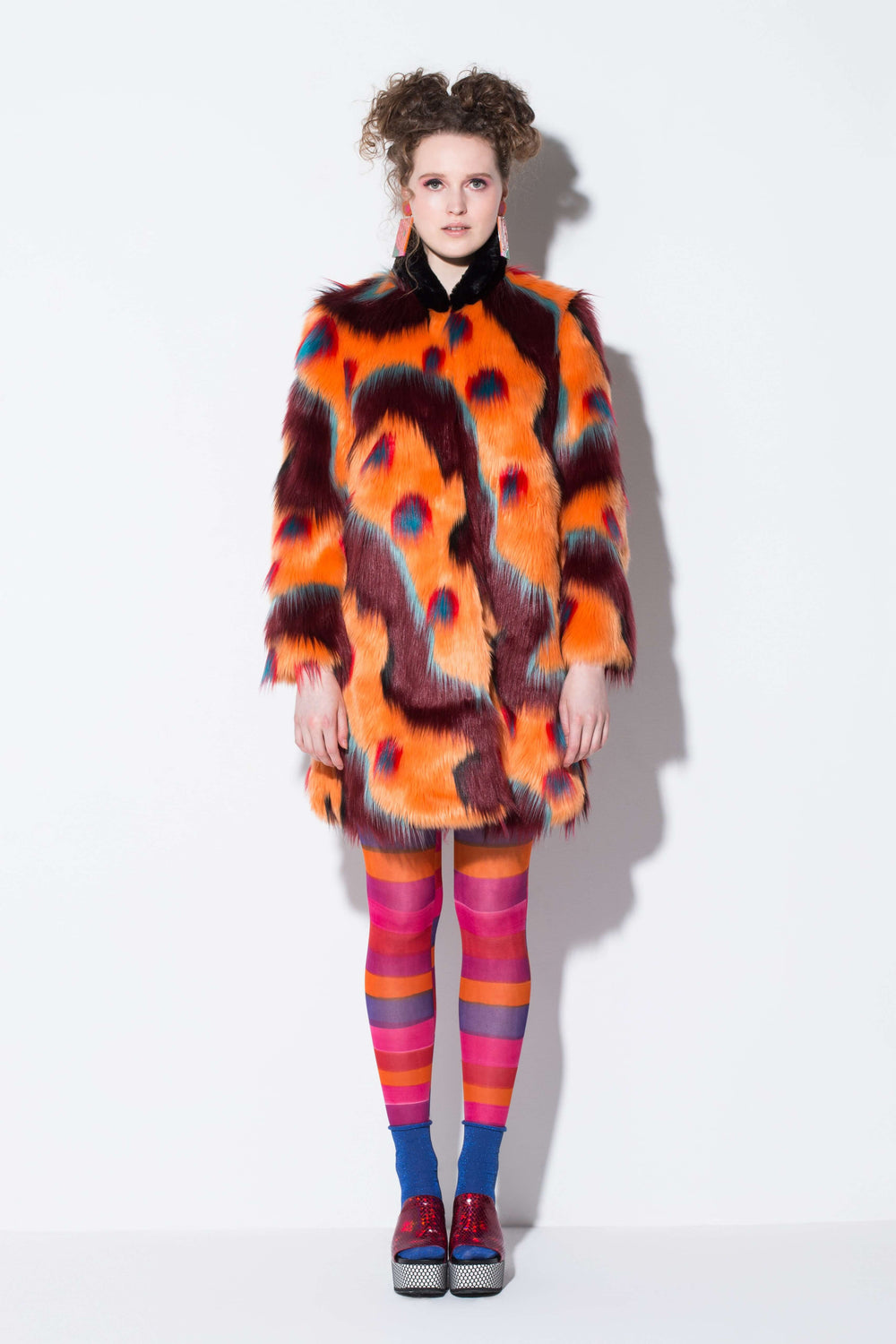 WaWa throw on coat| an easy wear faux fur coat in ORANGE desert pattern from jin & yin styled with hand-painted tights front view
