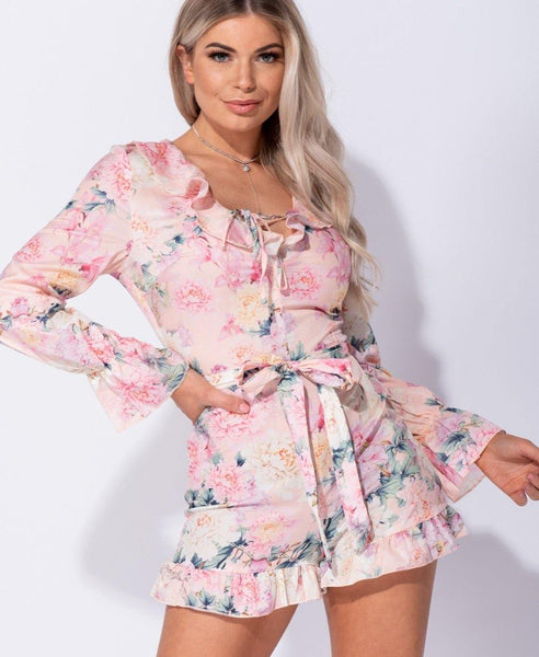 Pink floral jumpsuit/romper with long sleeves and shorts