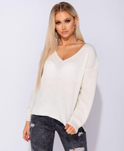 Ladies v-neck, long sleeved knit sweater in cream color