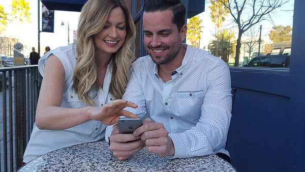 Woman sharing her photos on phone with a man