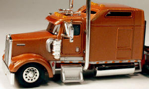 #T-5001 		Kenworth W900L with 86 in Studio Sleeper Carmel-Copper