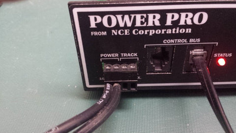 #410   NCE   4 pin connector plug for use with PH-Pro System Box, etc...  This connector is for AC power in from wall transformer ( 2 pins on the left) and Track power out ( 2 pins on the right )