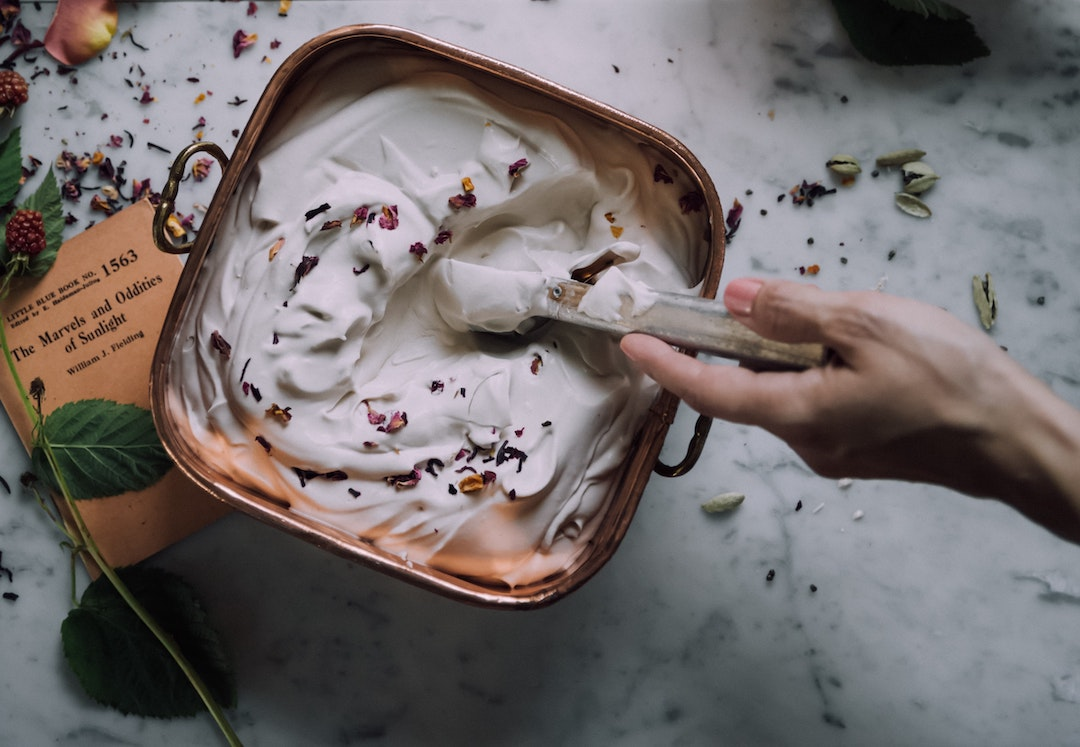 Image of a person using homemade ingredients for their DIY skincare routine with LEVO.