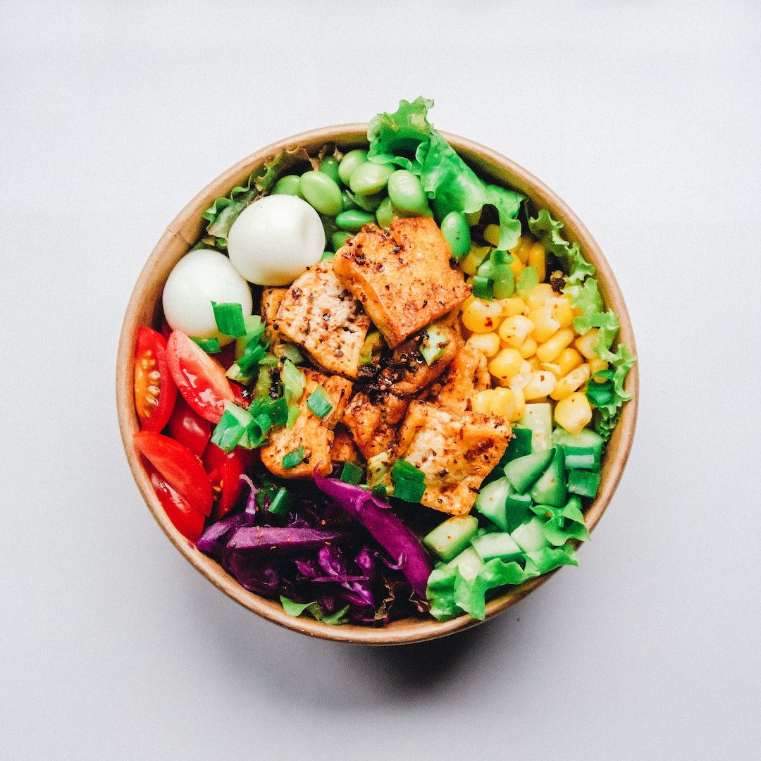 Image of a grain bowl with tofu made with LĒVO herbal infusion.