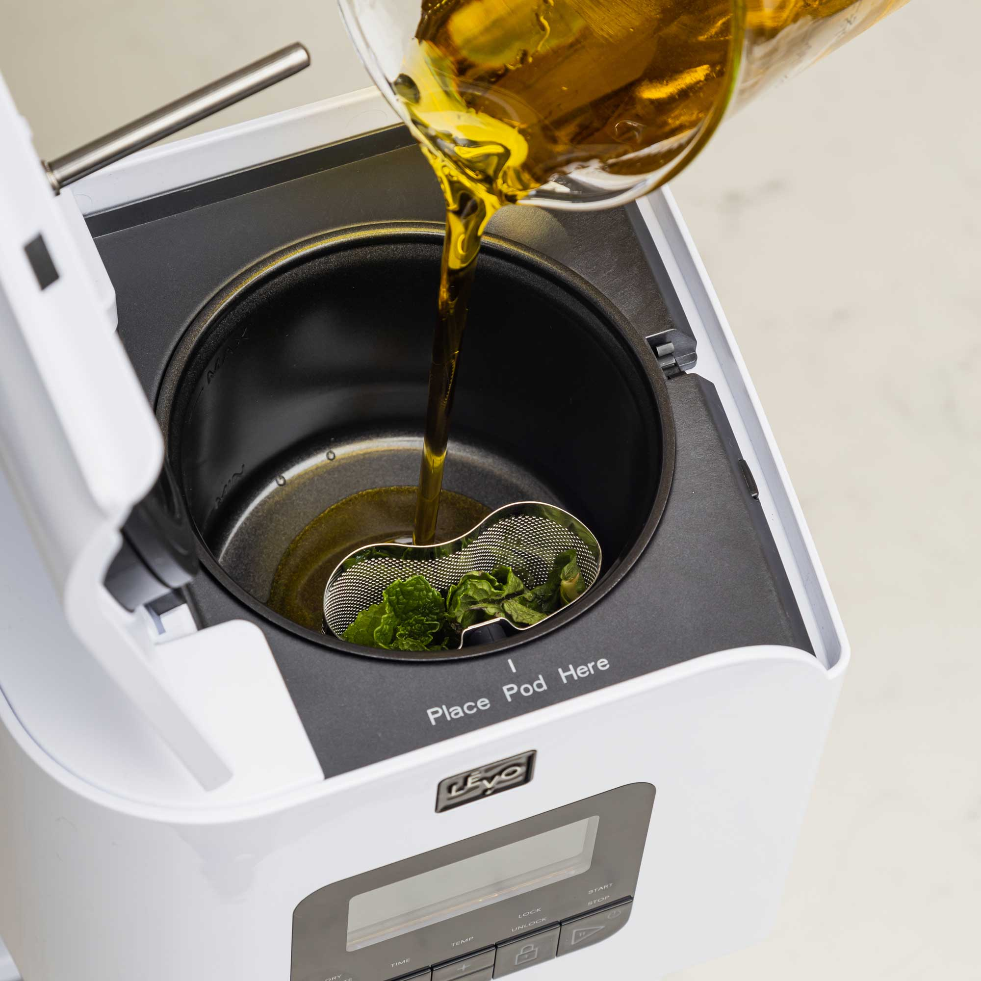To use LEVO II, simple add your herbs, spices, fruits, or flower to the herb pod, and add oil, butter, milk, honey, simple syrup, glycerine, or even beeswax to the reservoir, close the lid, and infuse.