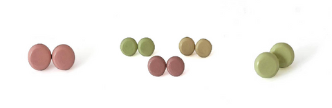 Round stud earrings in muted hues