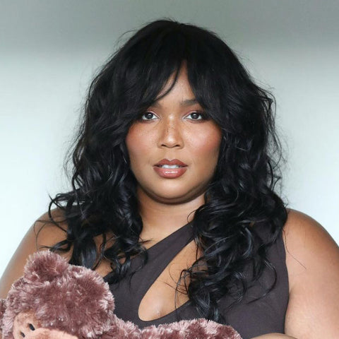 Lizzo with feathered 70's hair