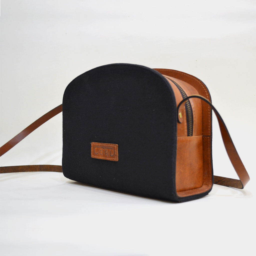 Black Essential Leather Sling Bag by Cord