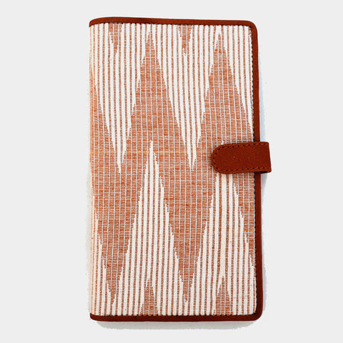 Carefully designed to accomdate passport, boarding pass and other travel documents, the grey and ivory passport wallet with a big woven chevron is handcrafted in handwoven fabric and genuine leather. by Cord