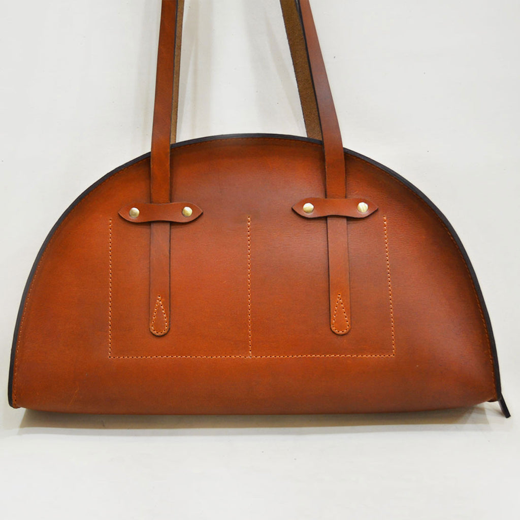 Tan Hemicycle Saddle Leather Bag by Cord