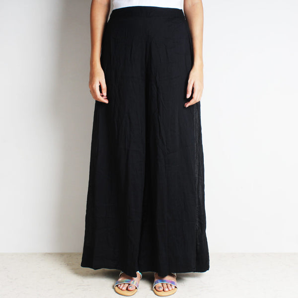 Black Mul Cotton Double Flared Pants by FLAME