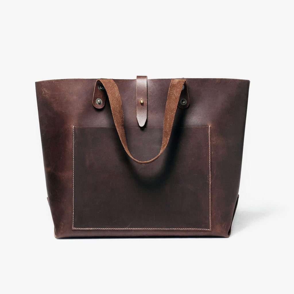 The perfect companion for those who prefer to wander light. Keep your most essential belongings by your side in this bag. Handcrafted with superior quality leather, this bag also features an adjustable strap. by Grain