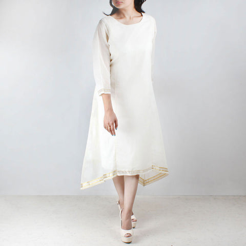 Off white asymmetric tunic with gold lace hemline by NOYA
