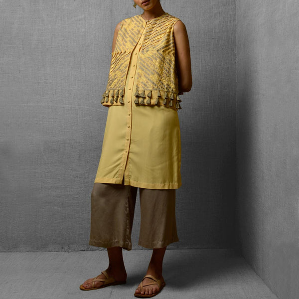 Set Of Yellow Rayon & Cotton Tunic With Cotton & Satin Cropped Wide Leg Pants & Attatched Linen Jacket by Kanelle by Kanika Jain