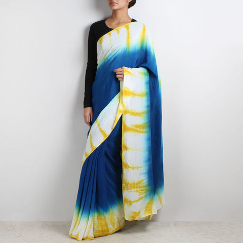 Blue Crepe Saree With Yellow & White Border by Marigold Weaves